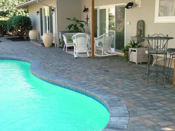 paver patio with pool design