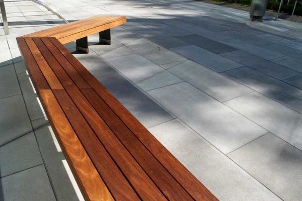 Large gray paver design with bench
