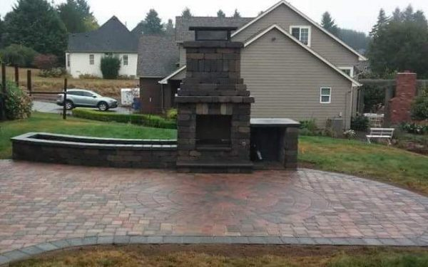 Gray Outdoor fireplace and paver patio in Olympia