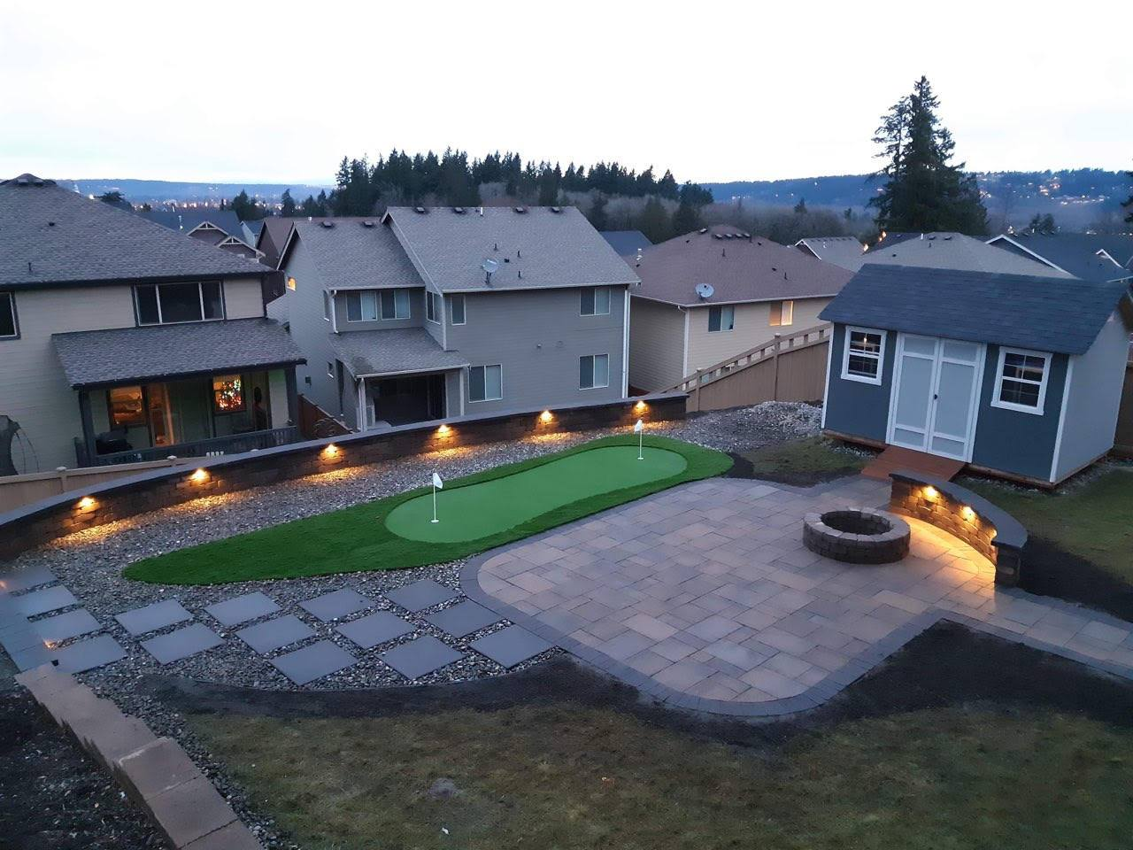 Synthetic Turf Backyard design with putting green and paver patio